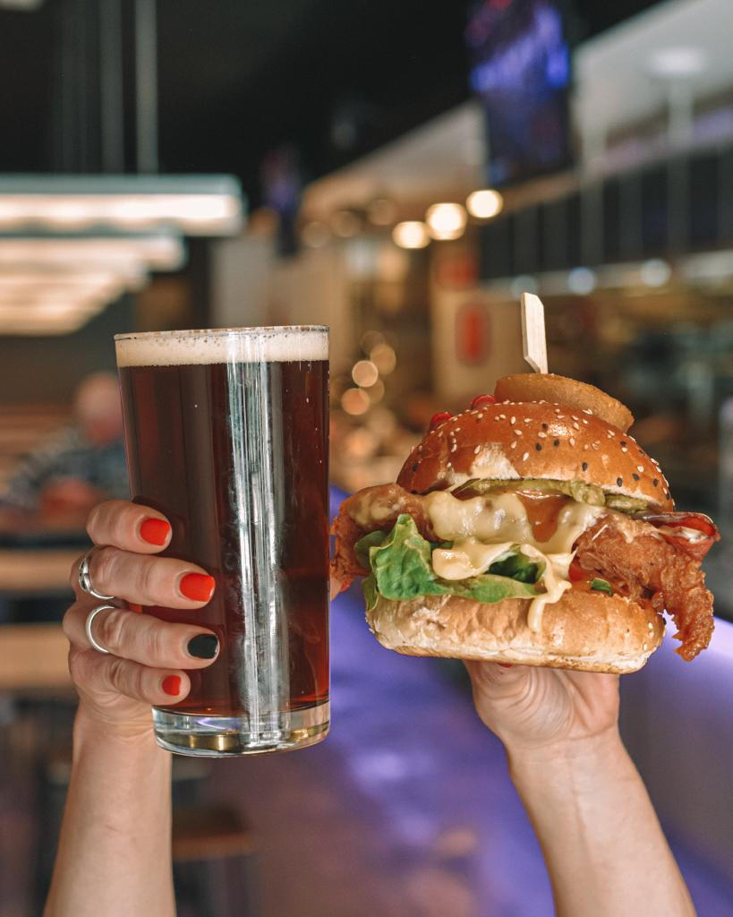 beer and burger being held in the air at beer and burger bar richmond
